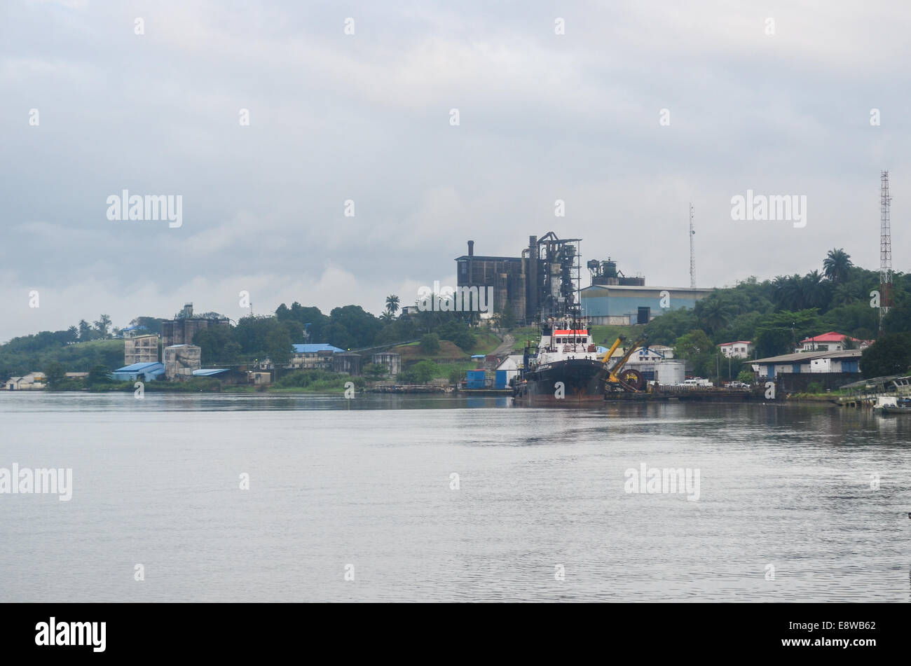 Cross River, where the oil pipelines run, and factory/plant, in Calabar, Nigeria - Stock Image