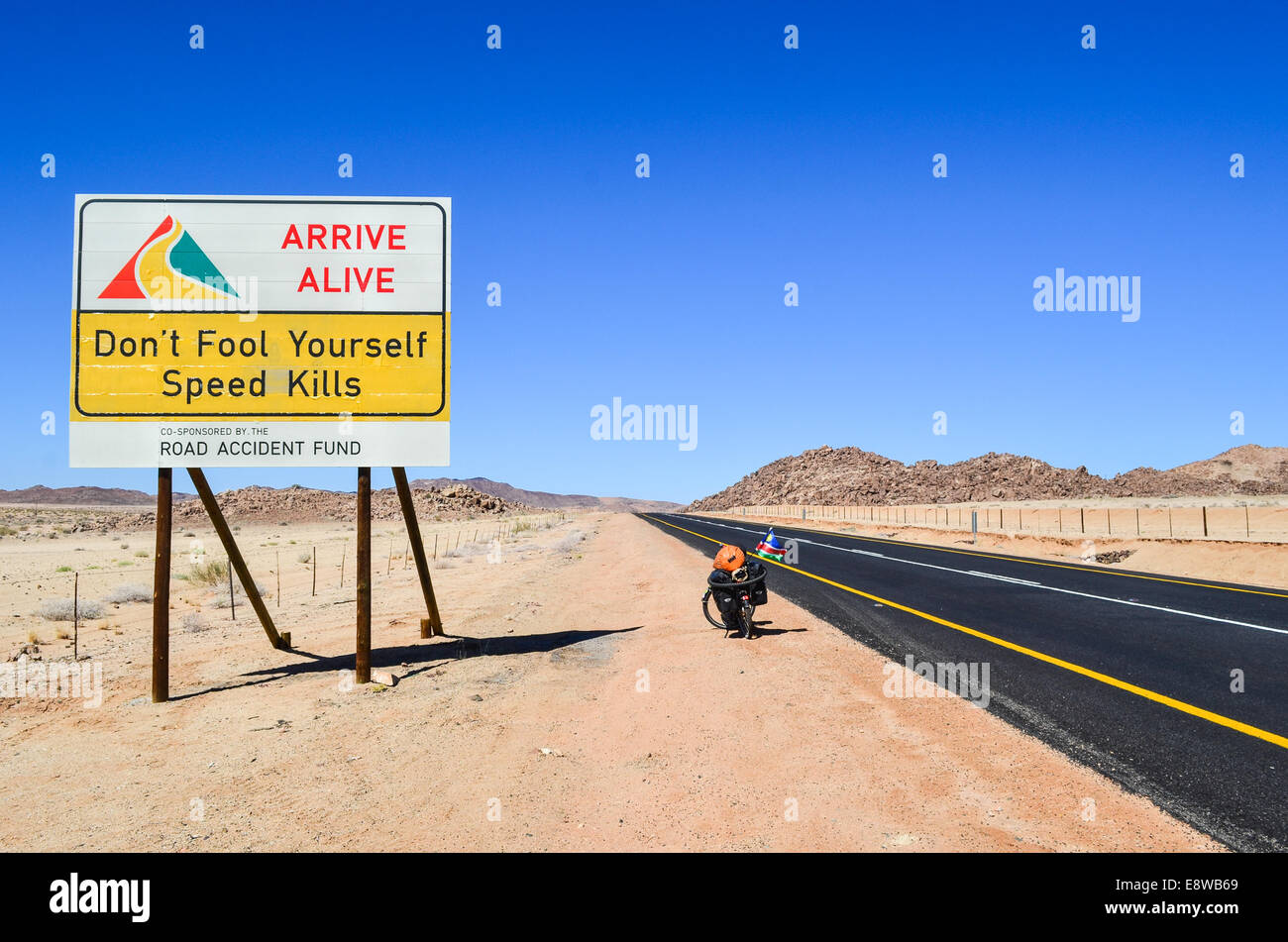 Road safety sign in South Africa, Northern Cape, reading 'Don't fool yourself, Speed kills' and a bicycle - Stock Image