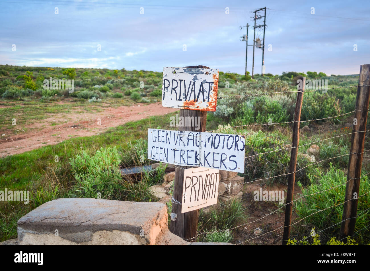 Signs of a private property in Afrikaans on a fence in South Africa - Stock Image