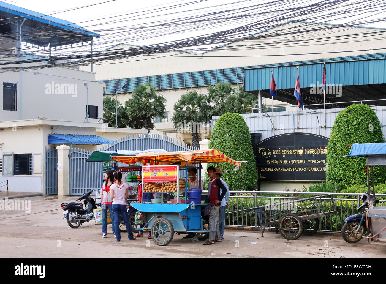 gate of a textile factory in the Pochentong industrial area in Phnom Penh, Cambodia. - Stock Image