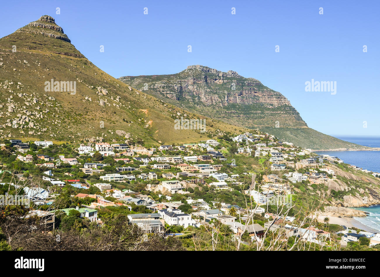Llandudno, a surfing hot spot, and the dramatic landscape of Chapman's peak drive, Cape Town peninsula, South - Stock Image