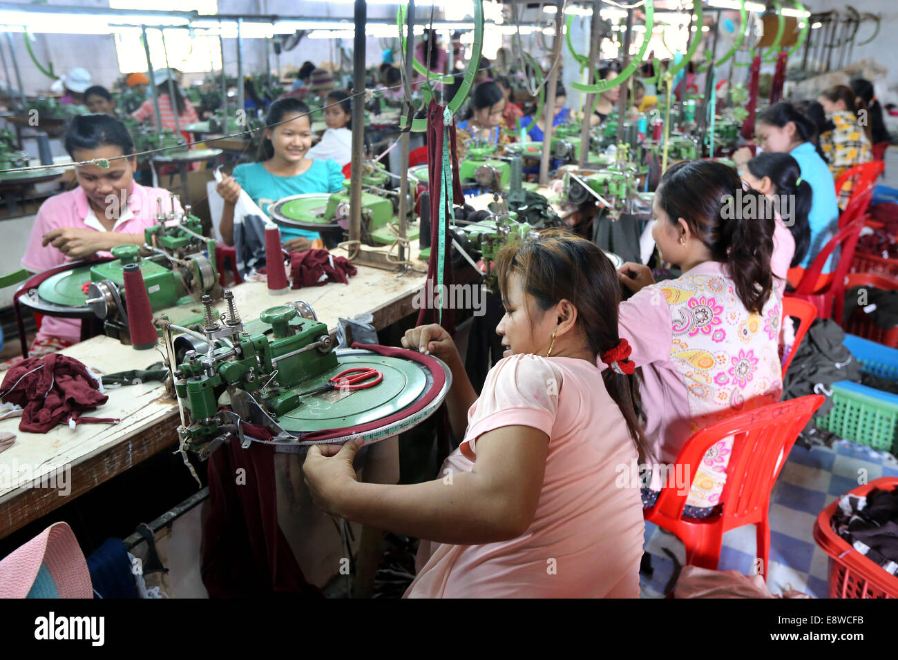 Female workers in a chinese operated textile factory in Thanaut Tee village, Takeo province, Cambodia, Asia - Stock Image