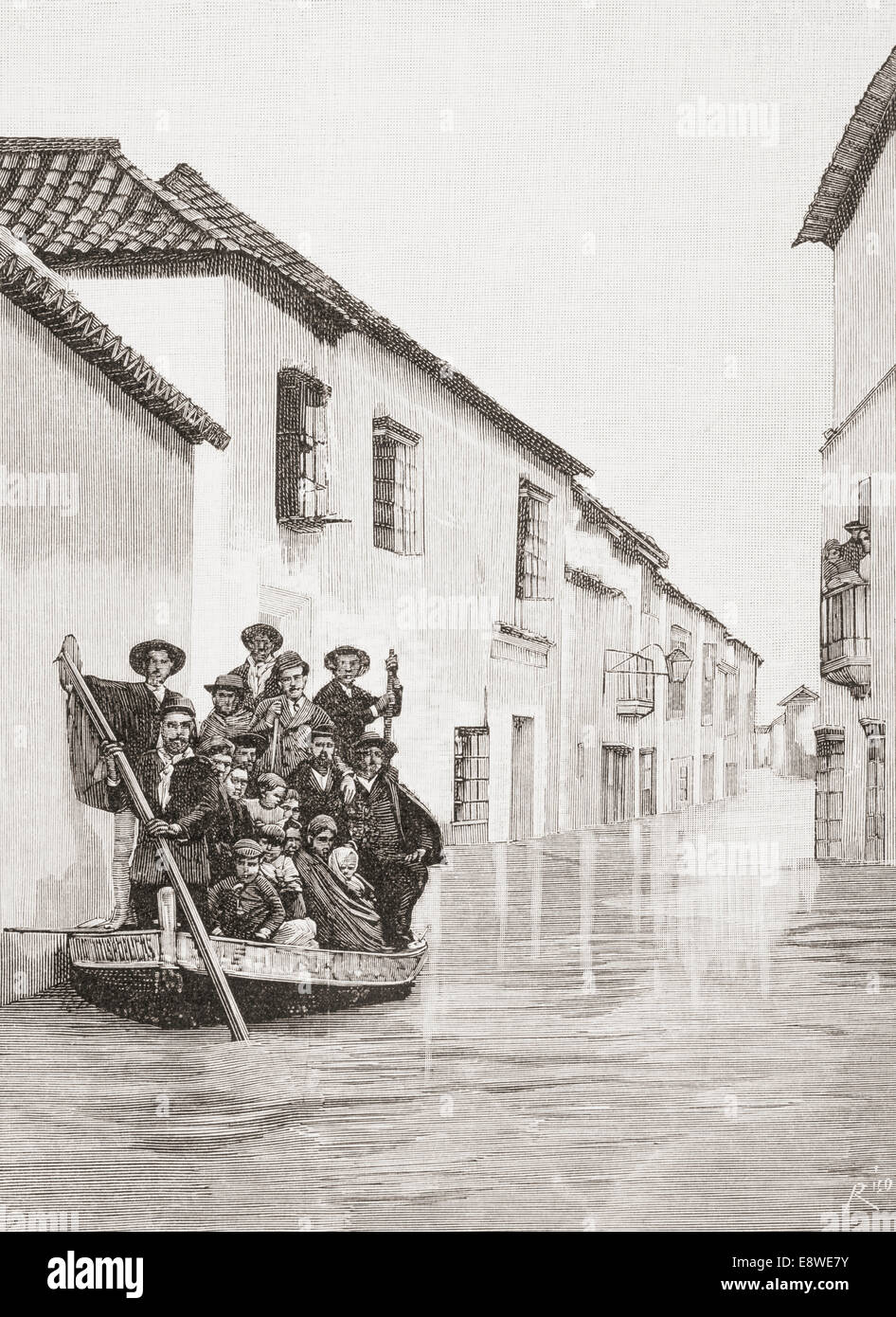 Seville, Spain. The mayor and his staff saving a family in the Calle Puente, under water during the terrible floods - Stock Image