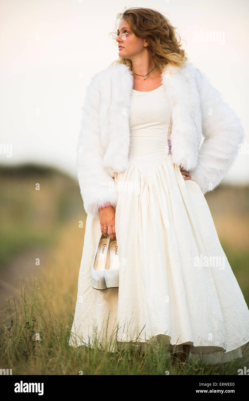 The runaway bride , a young woman girl in a wedding dress on
