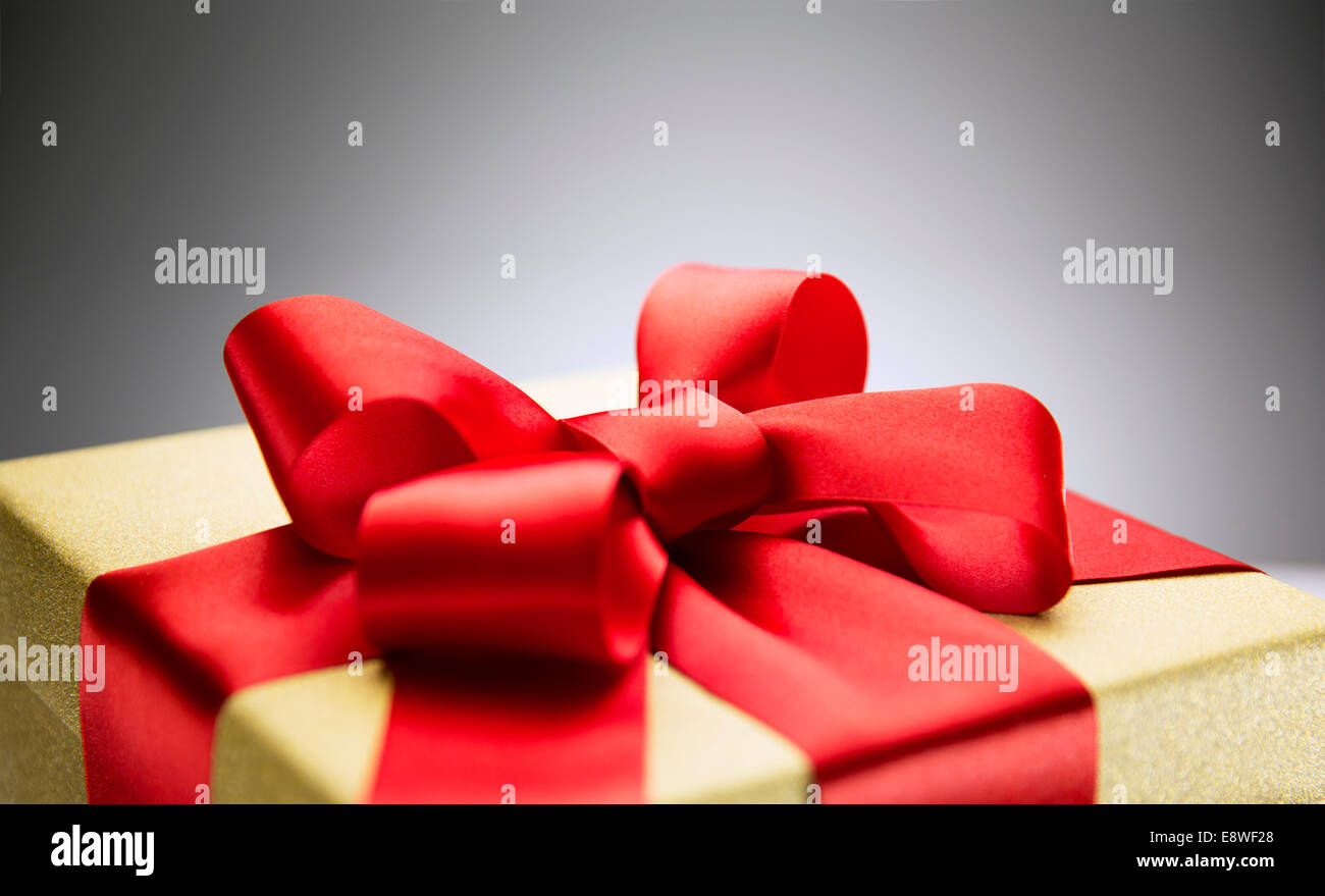 Close up of bow on wrapped gift - Stock Image