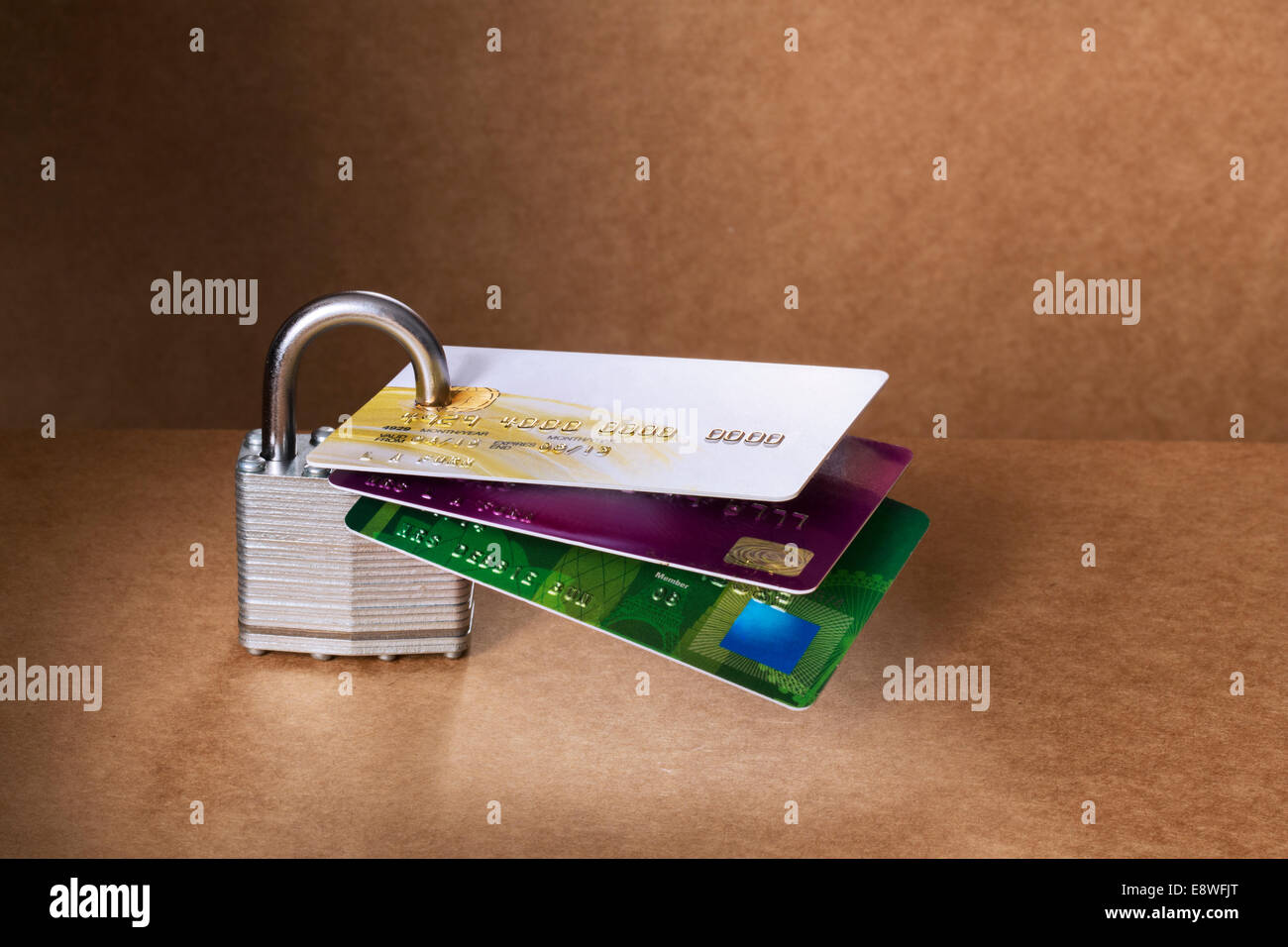 Credit cards attached to padlock - Stock Image