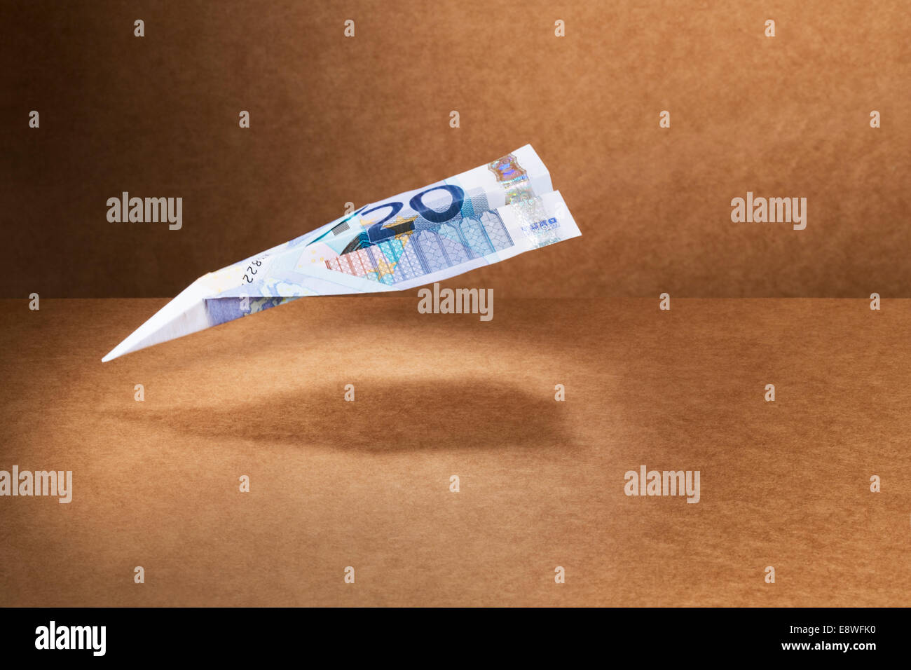 20 Euro note folded into paper airplane - Stock Image