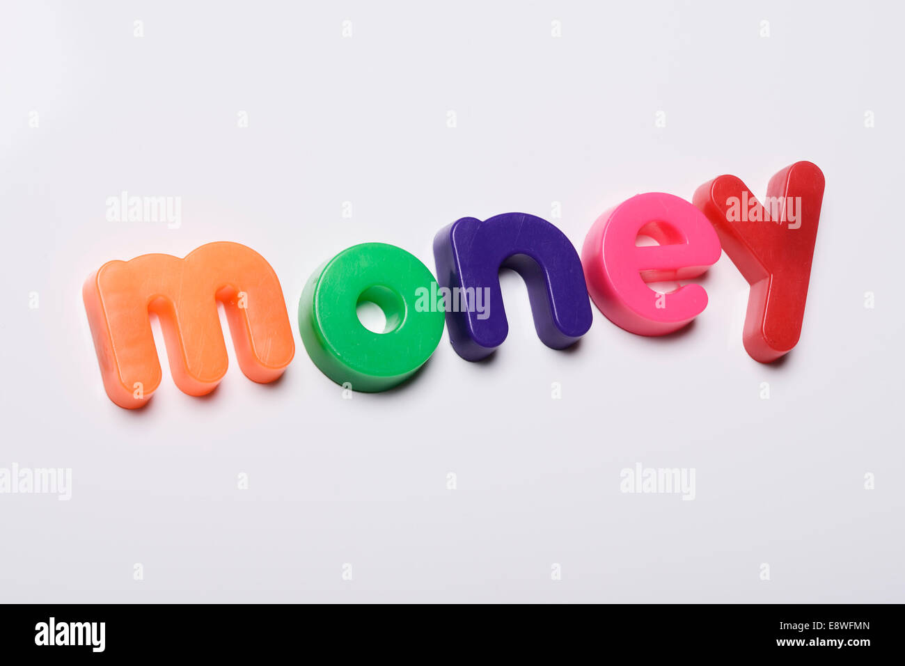 Money made from magnetic fridge letters - Stock Image