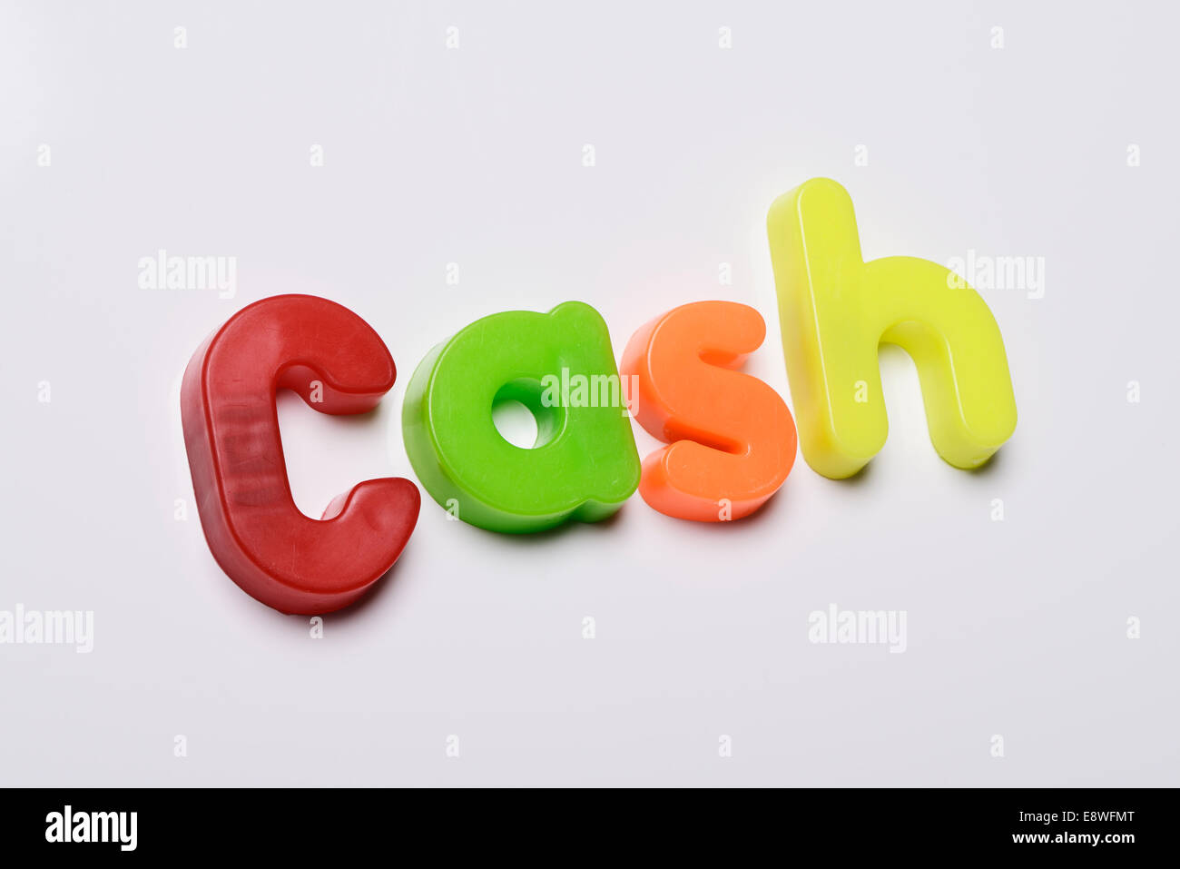 Cash made from magnetic fridge letters - Stock Image