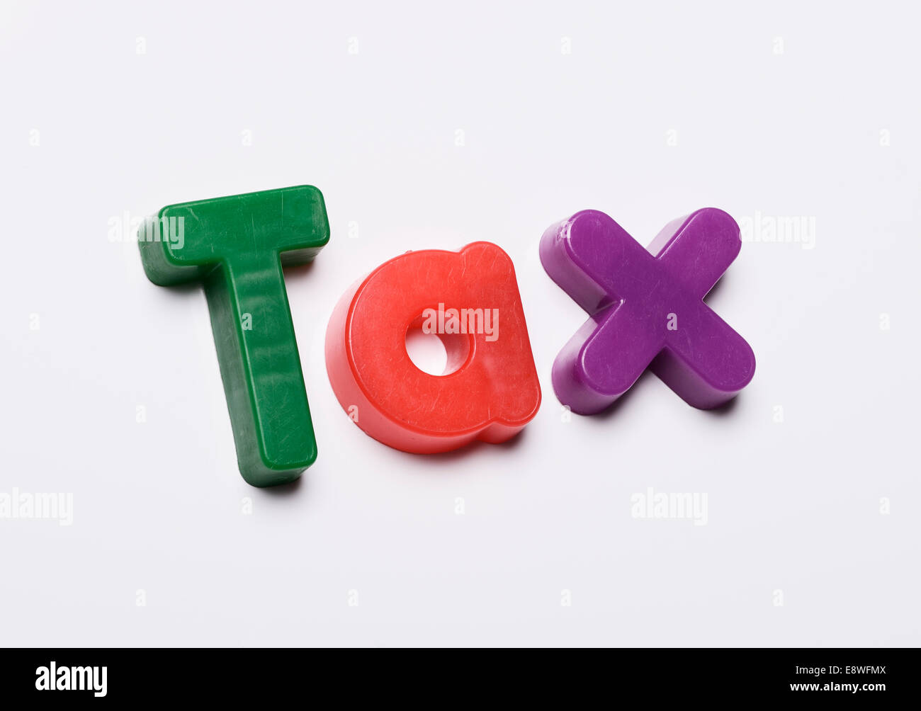 Tax made from magnetic fridge letters - Stock Image