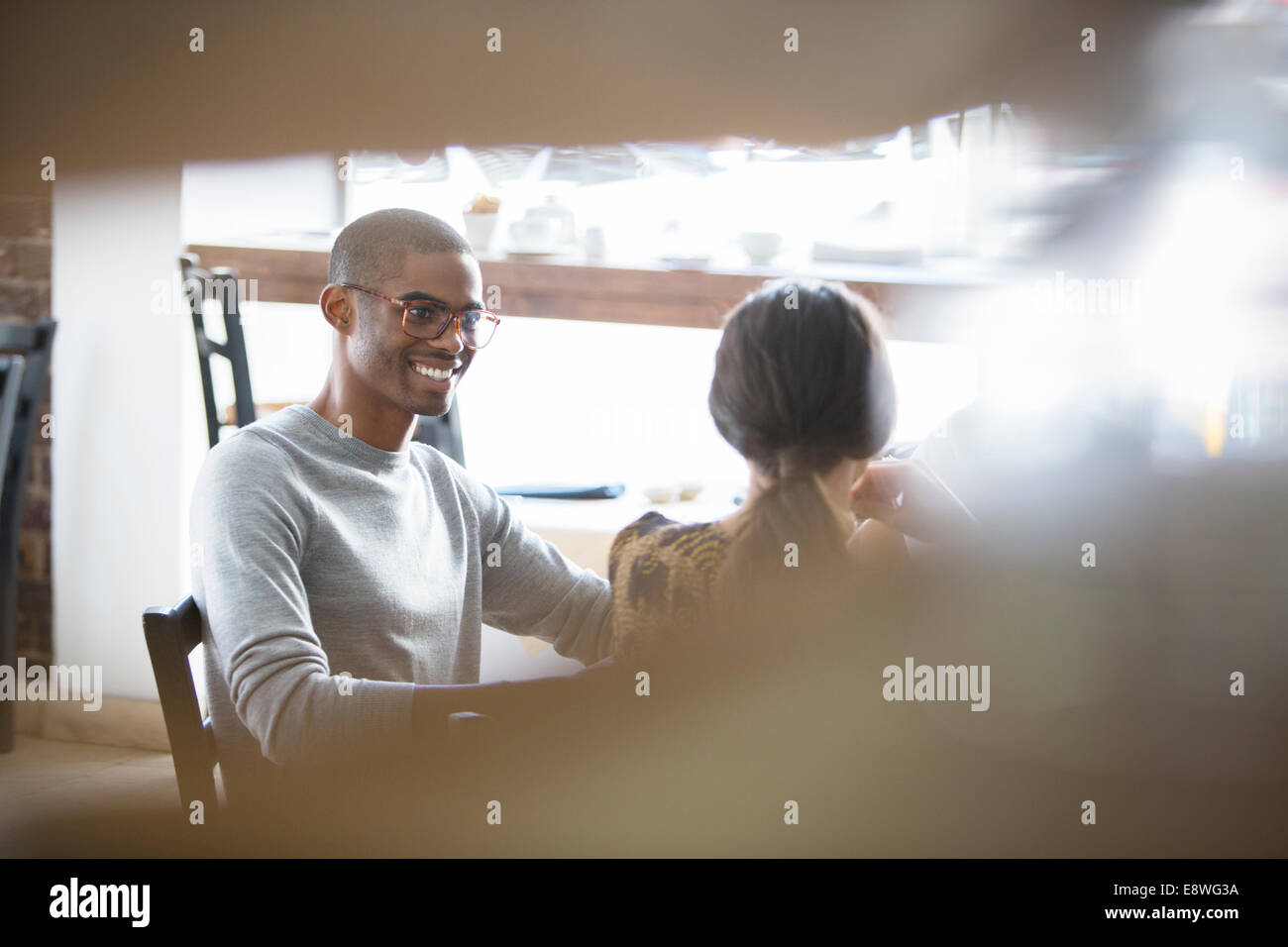 Couple talking in cafe - Stock Image