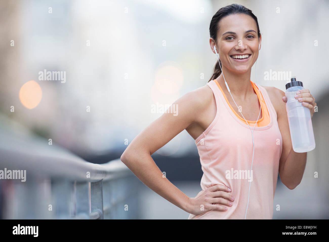 Woman drinking water outdoors - Stock Image
