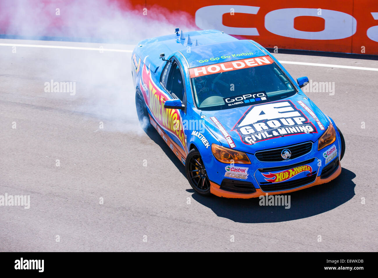 A blue Hotwheels display team 'Ute' or Pick Up truck drifting round the iconic Bathurst racetrack - Stock Image