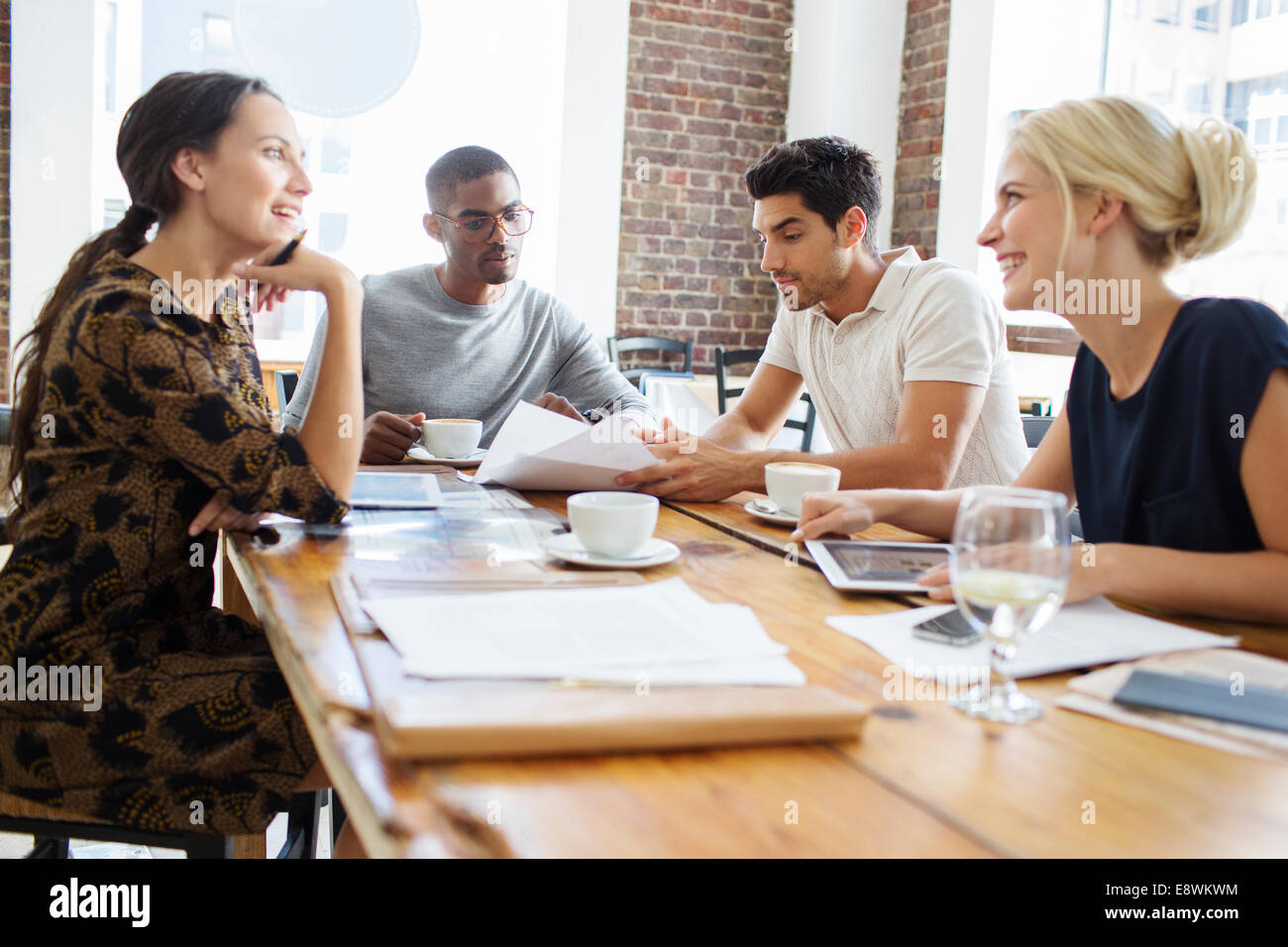 Business people talking at meeting in cafe - Stock Image