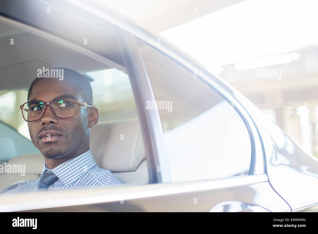 Business man sitting in car back seat Stock Photo