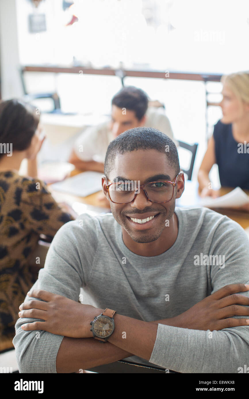 Businessman smiling in cafe - Stock Image