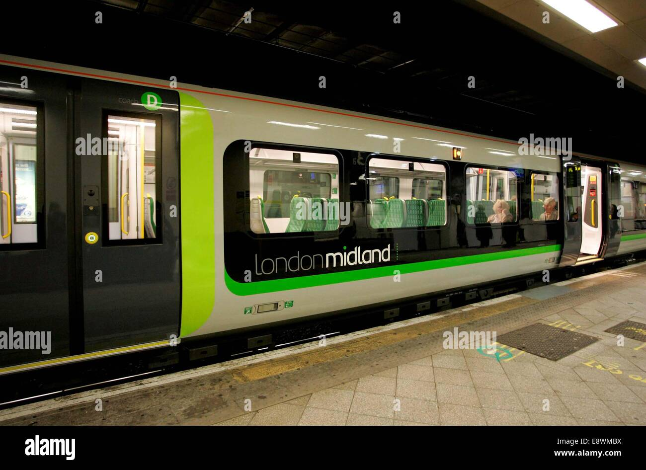 A London Midland branded train at Birmingham's New Street station. - Stock Image