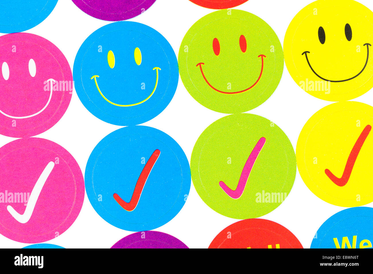 Tick off and smiley stickers - Stock Image