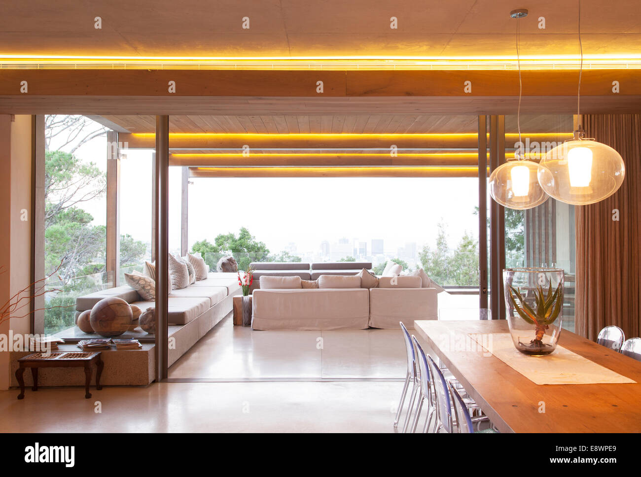 Sliding Glass Doors Between Open Modern Living And Dining Rooms