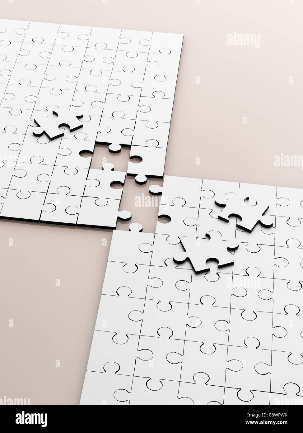 Close up of connecting puzzle with scattered pieces Stock Photo