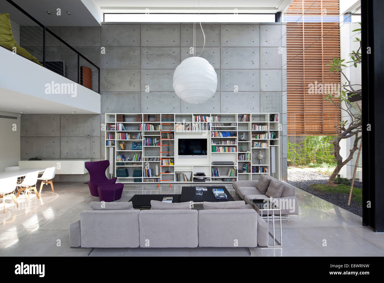 Double height living room with bookcase in Dahan House Israel Middle East. - & Large Double Height Open Plan Living Room Stock Photos \u0026 Large ...