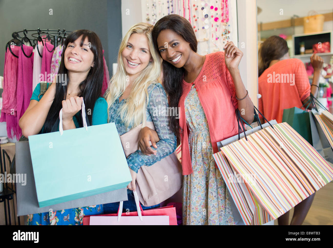 8d01f931da Women shopping together in clothing store Stock Photo: 74326647 - Alamy