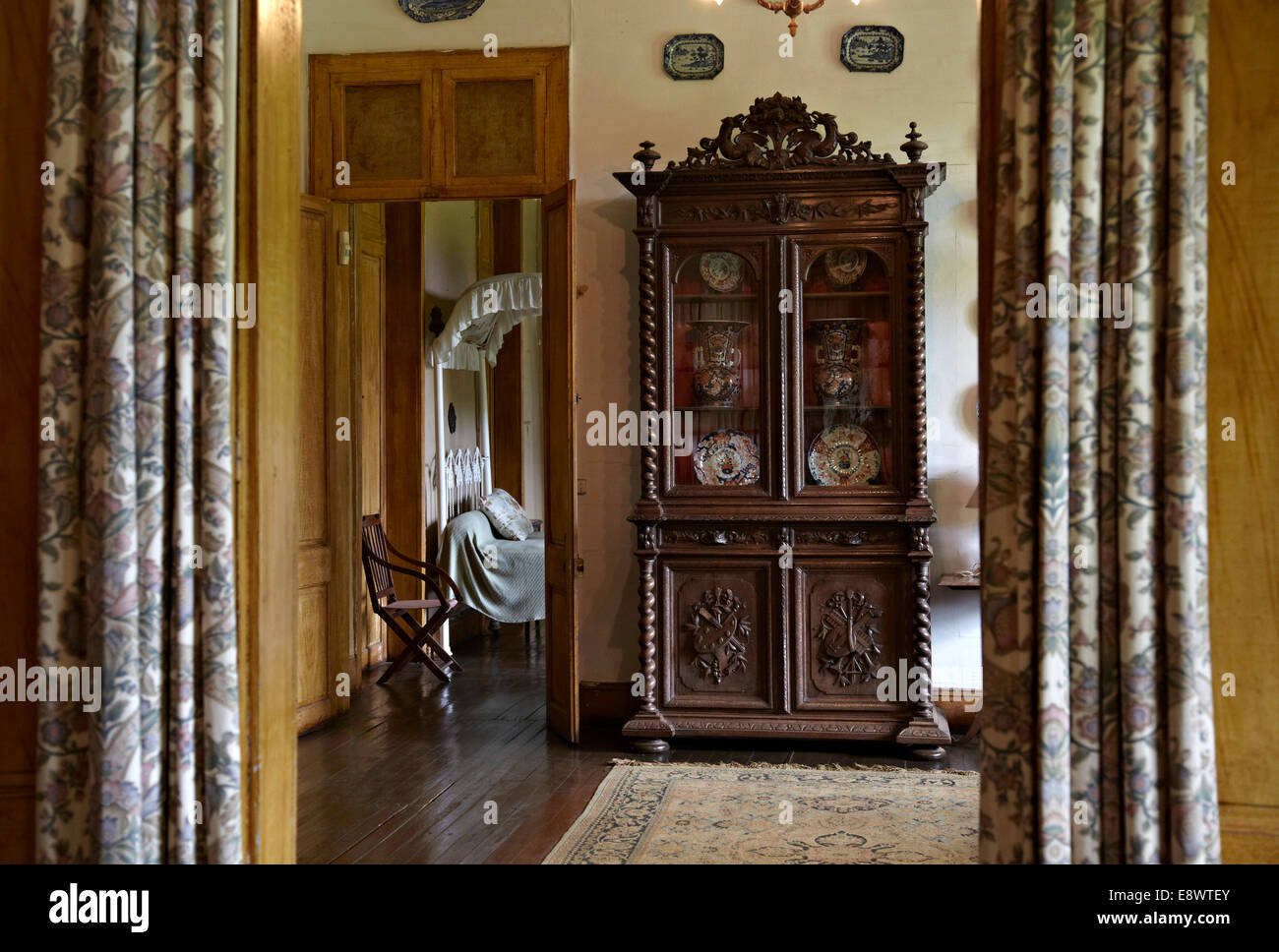 View through curtains to cabinet in La Maison Creole a French colonial house Eureka house & Colonial Interior Colonial Interiors Stock Photos \u0026 Colonial ...