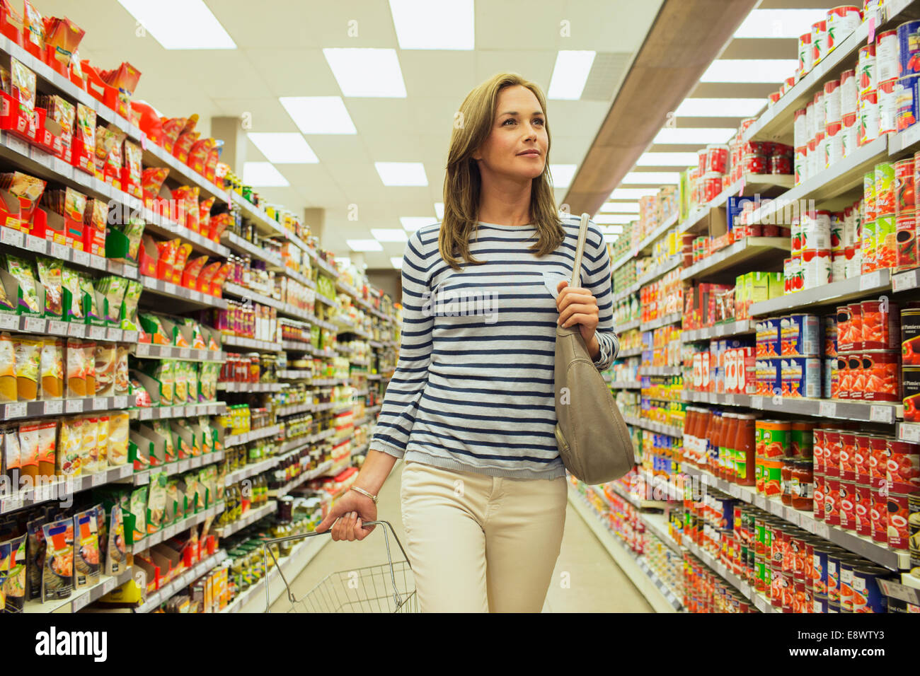 customers shopping at a grocery store - 1236×695