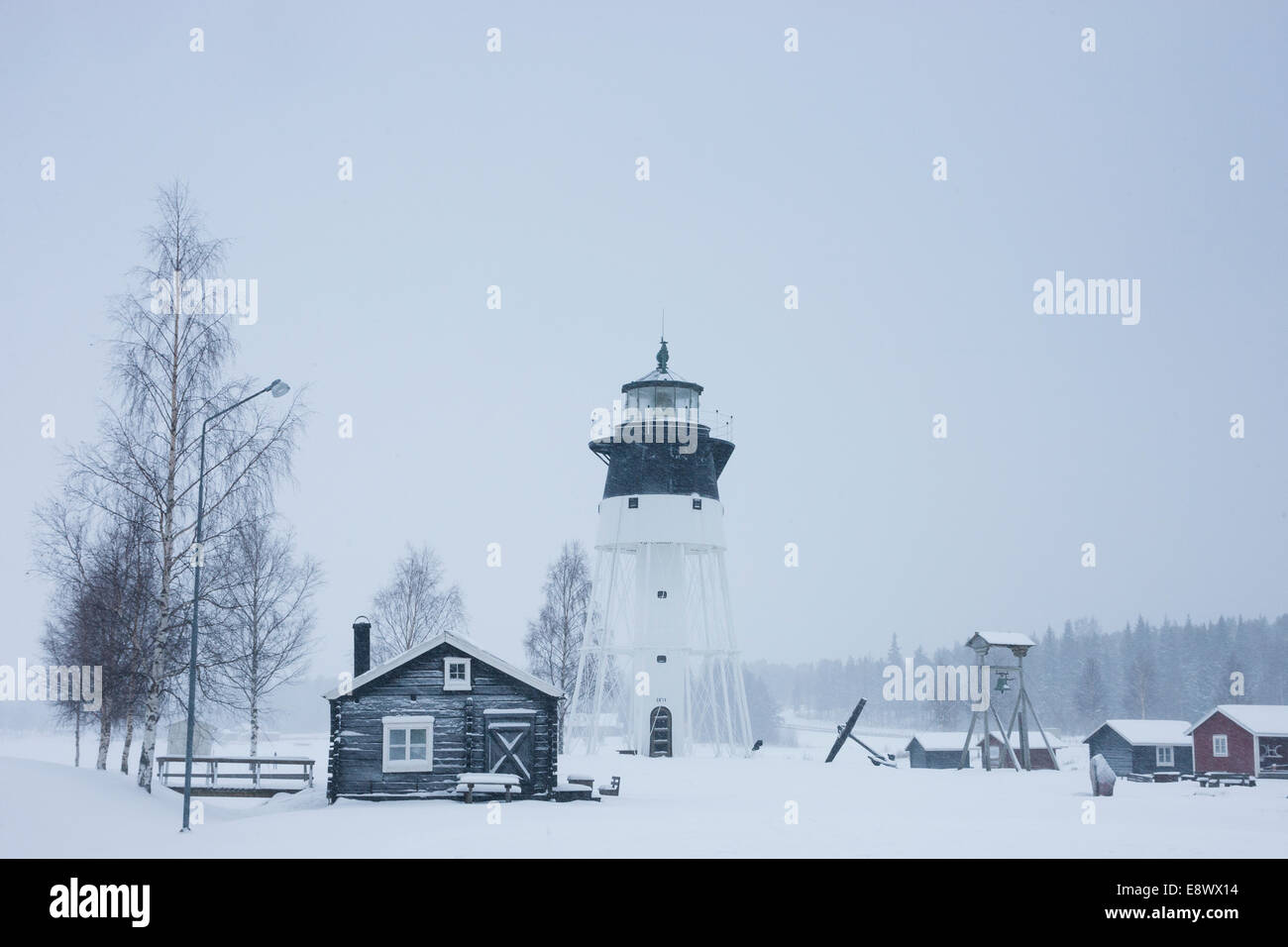 JAVRE, SWEDEN Lighthouse and traditional wooden structures Stock Photo