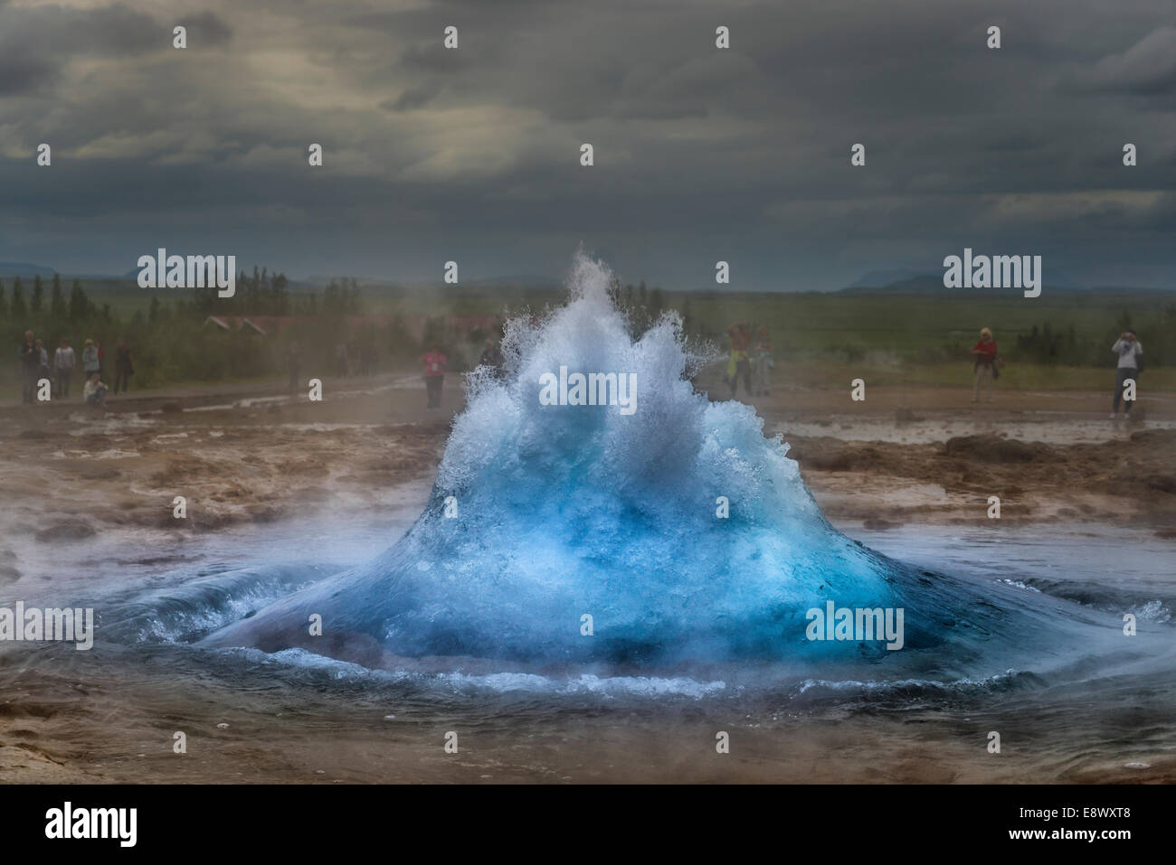 Strokkur about to erupt. Strokkur is a fountain geyser by the Hvita River in the Haukadalur valley, Iceland. - Stock Image
