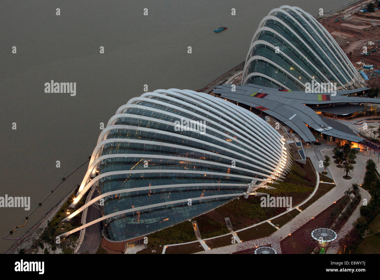 Evening view of cooled conservatories at Gardens by the Bay, Singapore - Stock Image