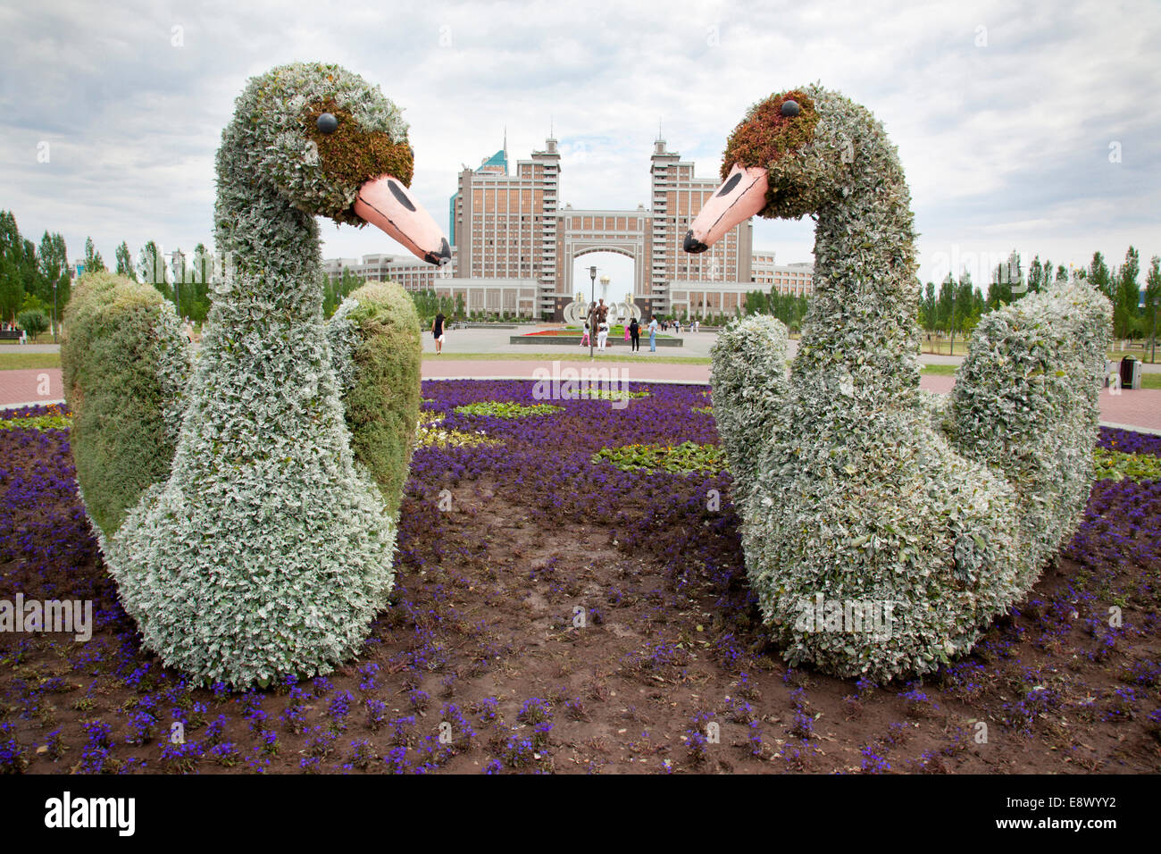Manicured garden swans in front of the Kaz Munai Gas Building in the central business district of Astana were part - Stock Image
