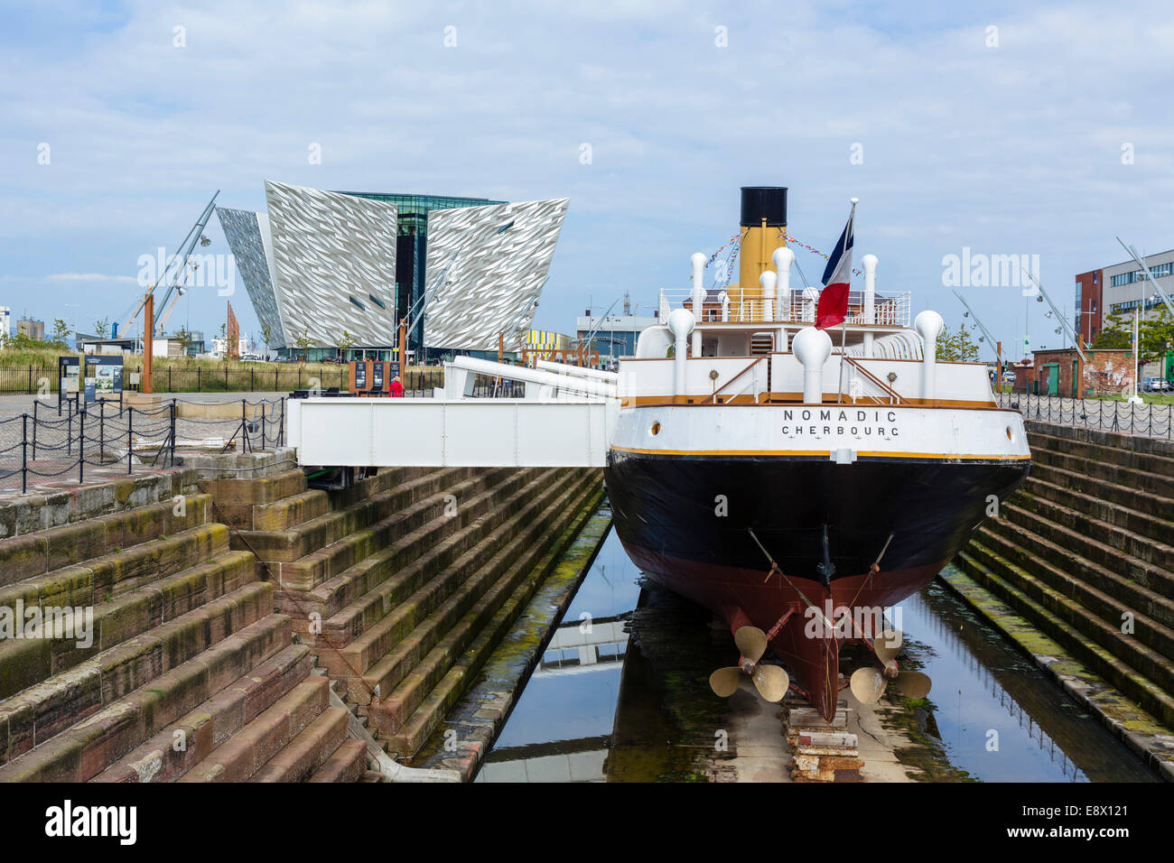 The steamship tender SS Nomadic with Titanic Belfast museum behind, Titanic Quarter, Belfast, Northern Ireland, - Stock Image