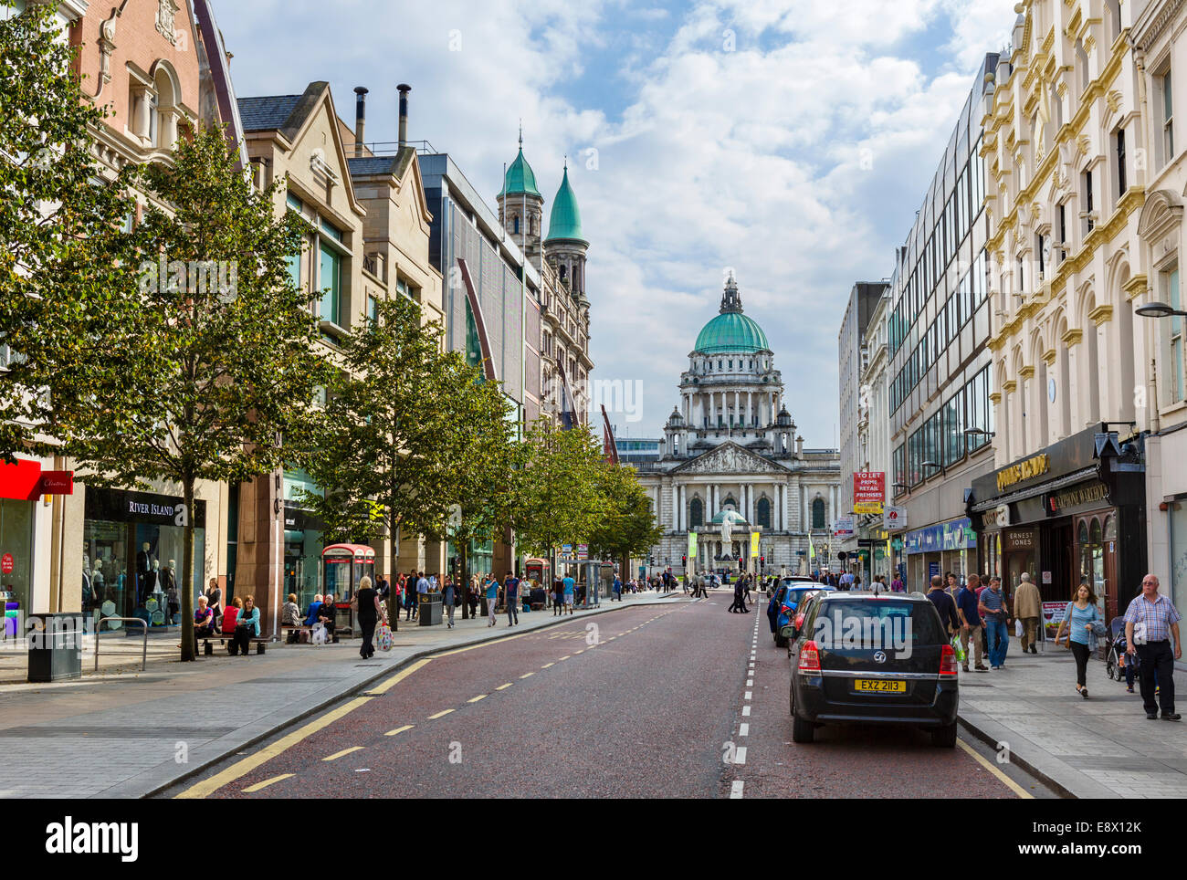 Shops on Donegall Place looking towards City Hall, Belfast, Northern Ireland, UK - Stock Image