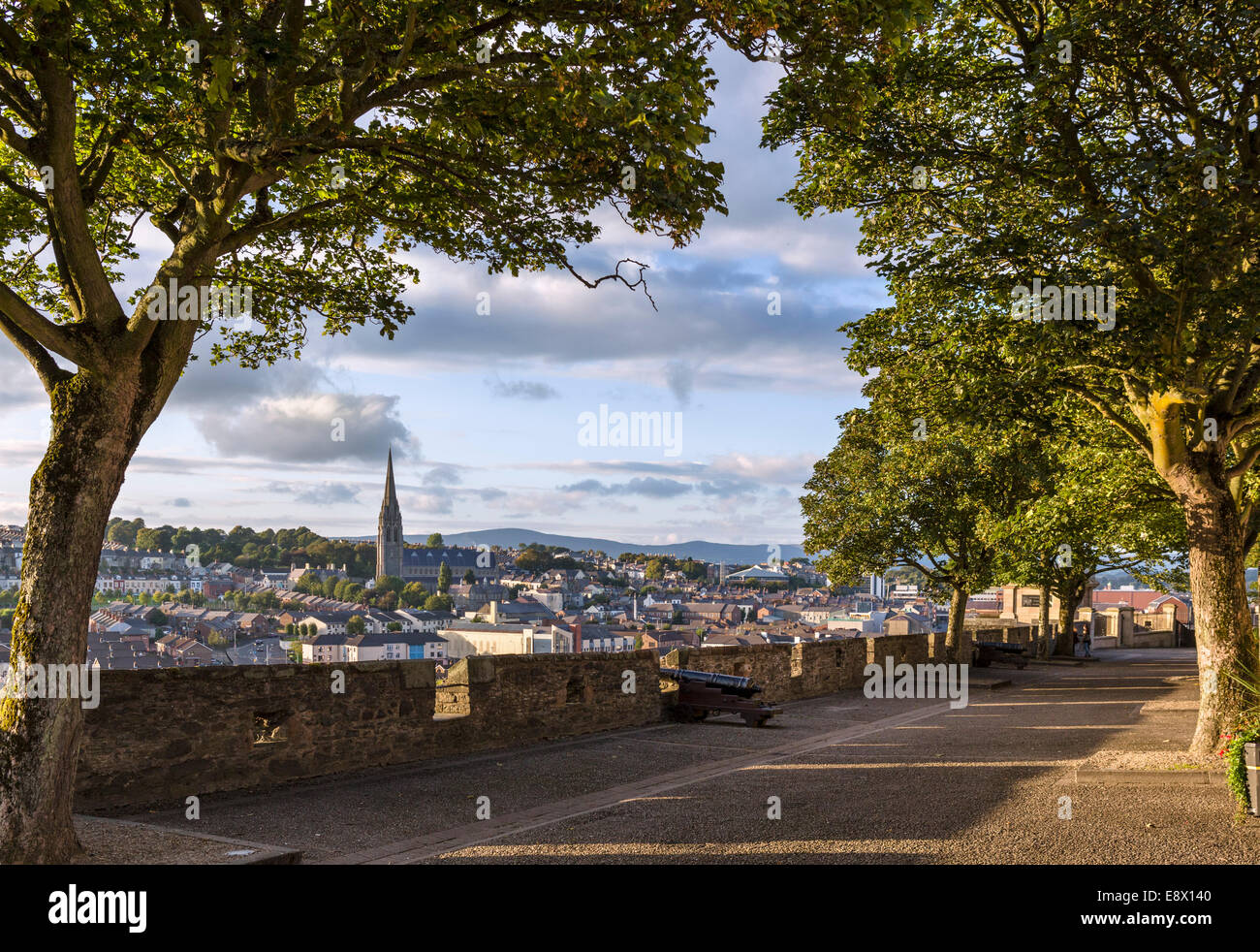 Old city walls in the early evening with St Eugene's Cathedral in the distance, Derry, County Londonderry, Northern - Stock Image
