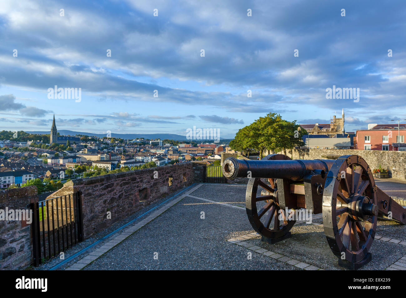 Cannon on the Royal Bastion of Old City Walls with Bogside behind, Derry, County Londonderry, Northern Ireland, - Stock Image