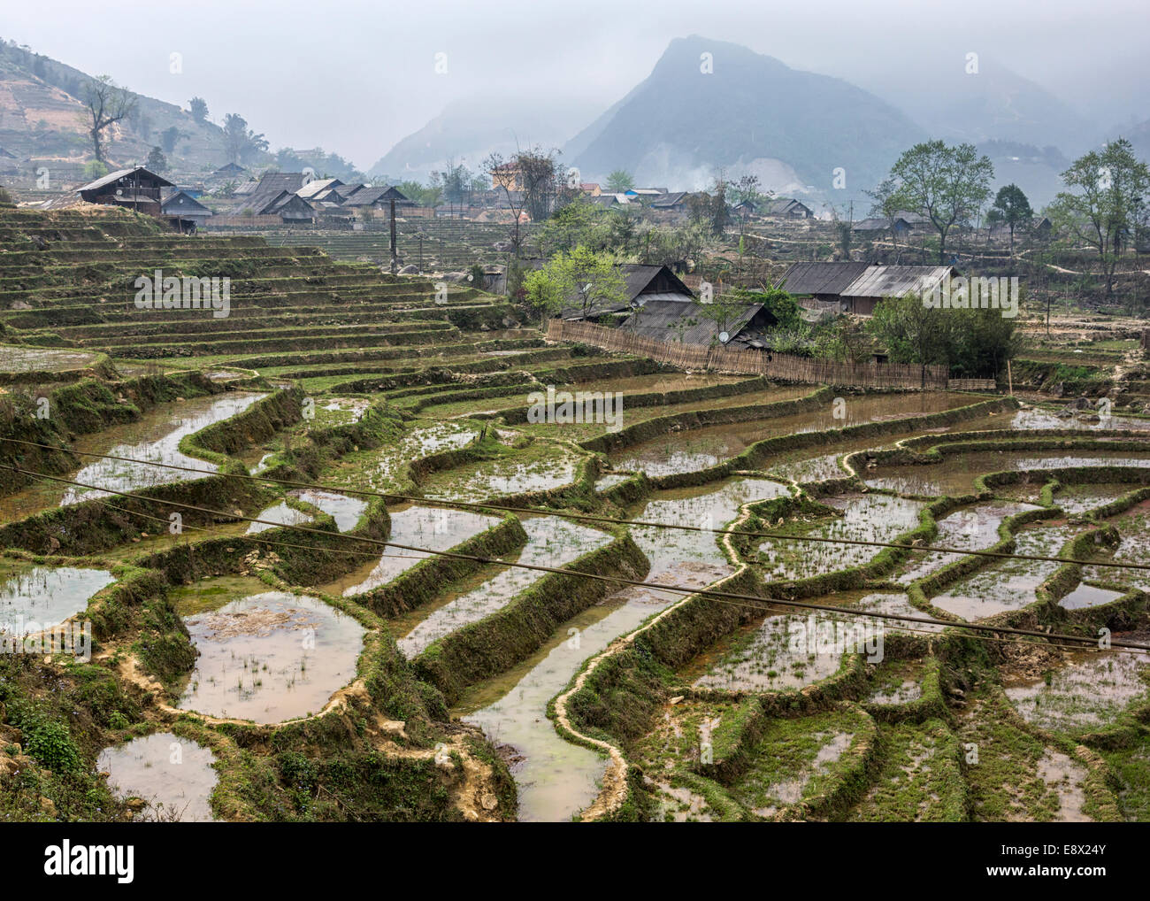 Terraced rice paddies and Hmong village in the Northern mountains. - Stock Image