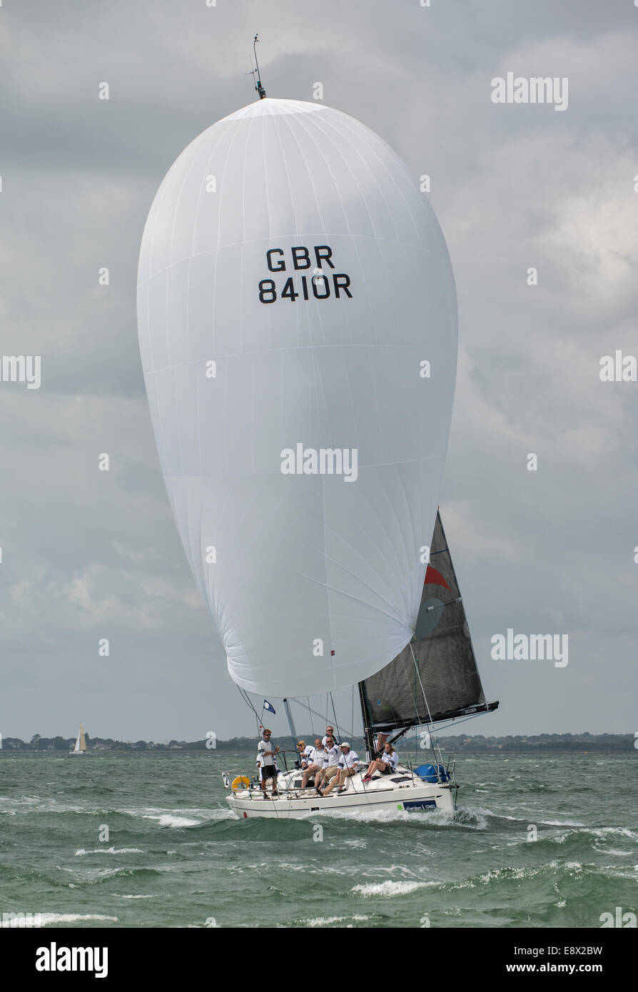 Racing Yacht Premier Flair an Elan 410, Sail Number GBR8410R with spinnaker deployed in the Solent during the 2014 - Stock Image