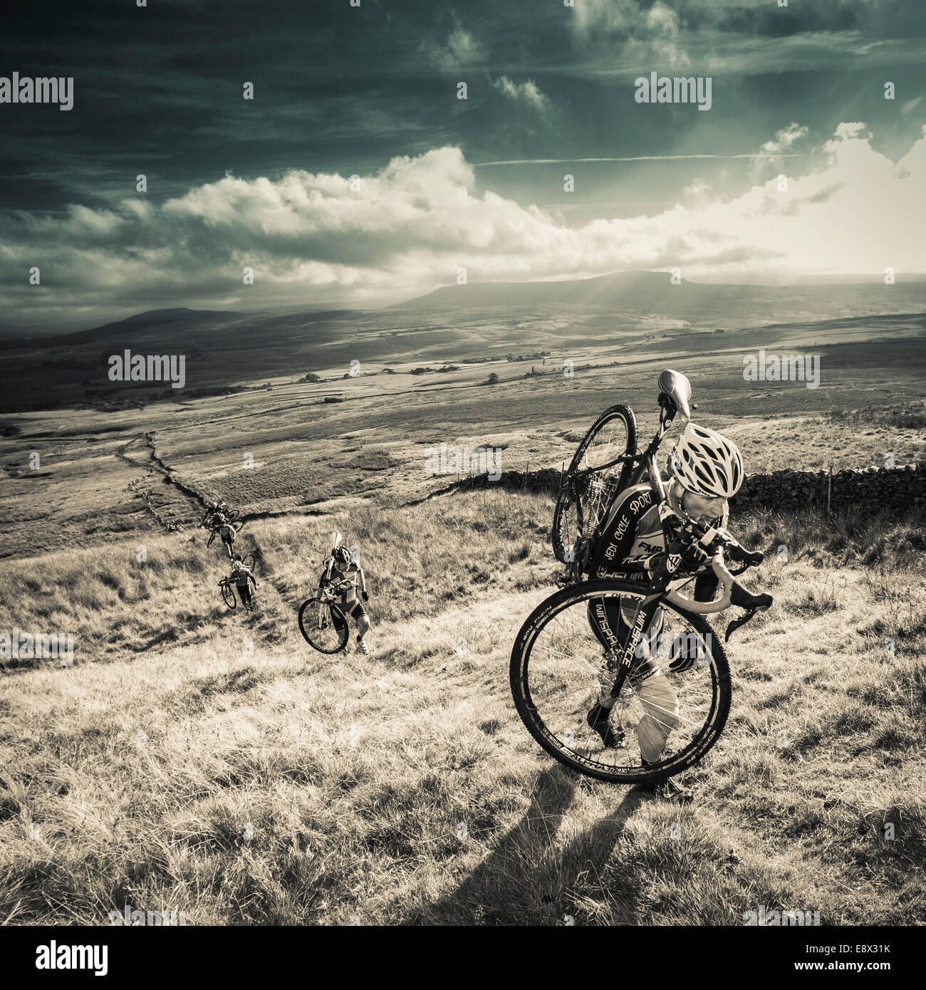 Rider climbing Simon Fell, Three Peaks cyclocross, Yorkshire Dales, UK - Stock Image