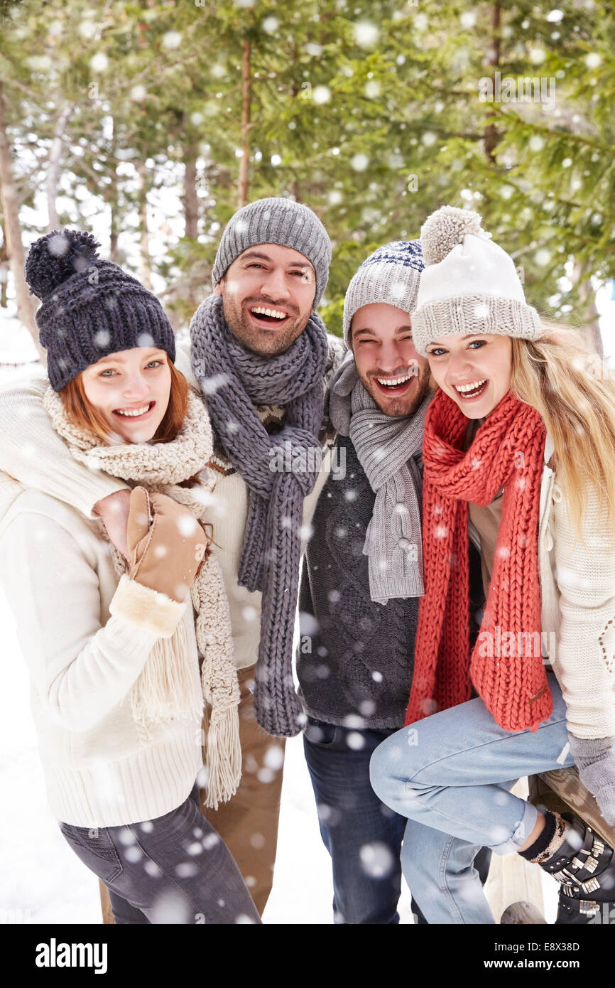 Friends hugging in the snow - Stock Image