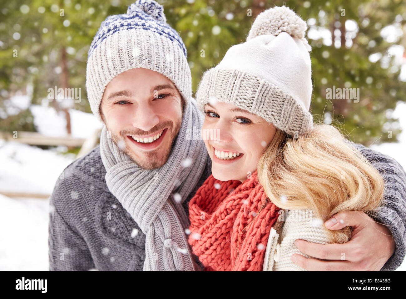 Couple hugging in the snow - Stock Image