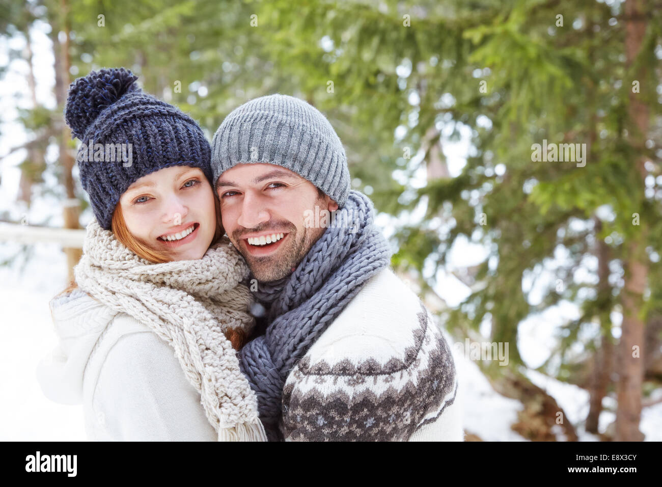 Couple hugging in snow Stock Photo