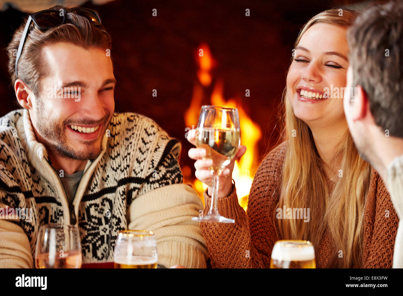 Friends enjoying a meal together - Stock Image