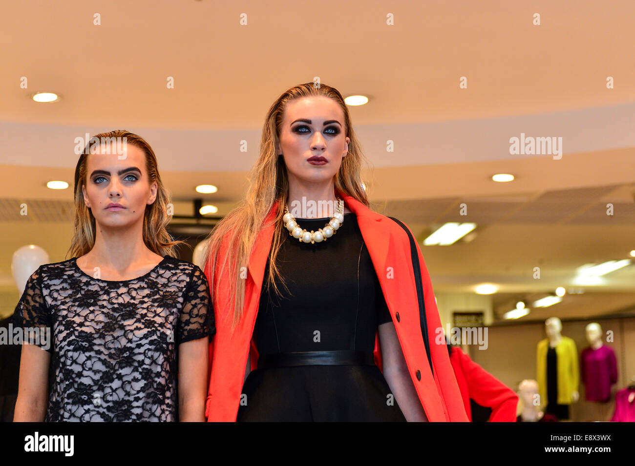 Stock Photo - Two women posing as live models in Dunnes Stores, Derry, Londonderry, Northern Ireland. ©George - Stock Image