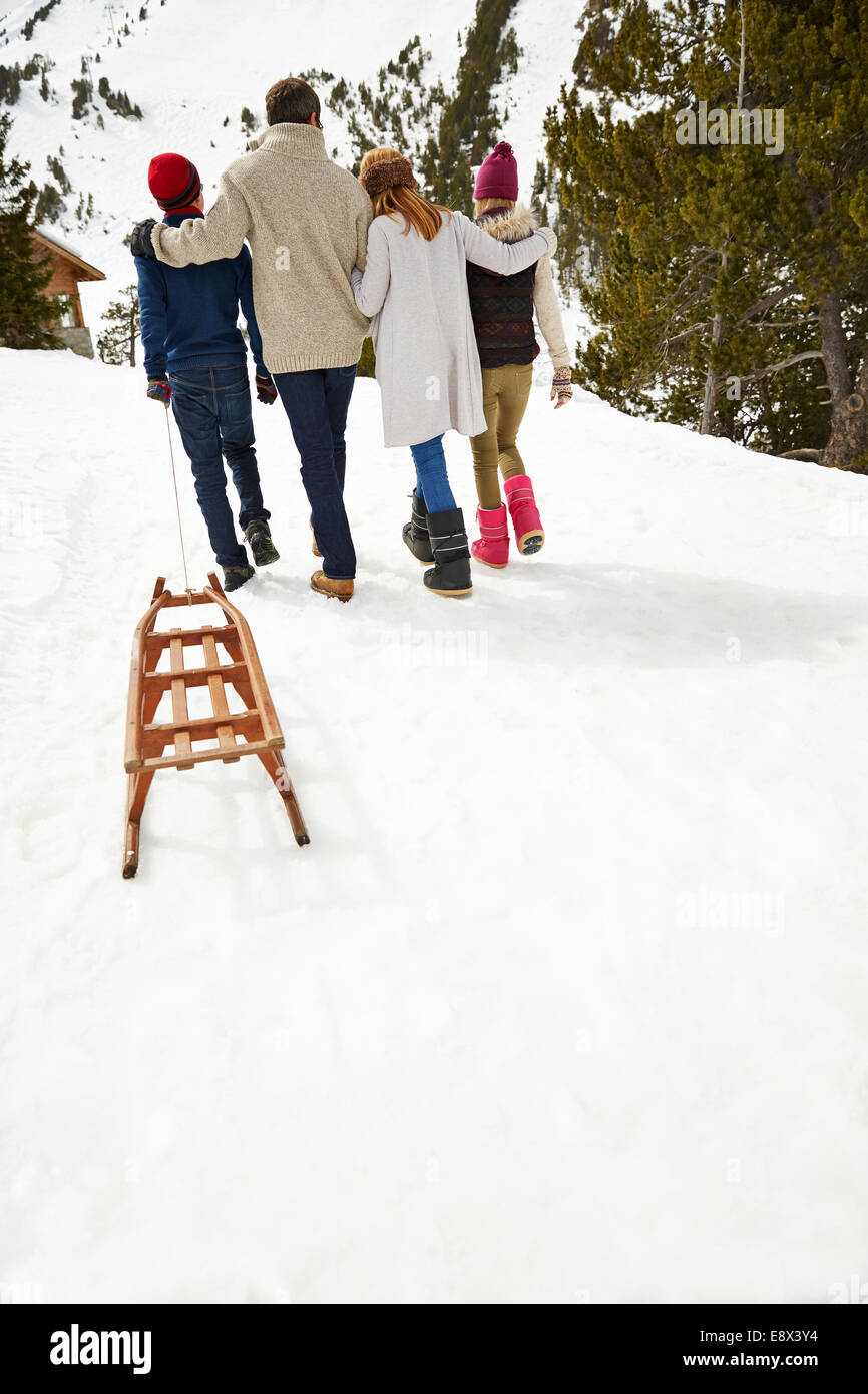 Family walking in snow together - Stock Image