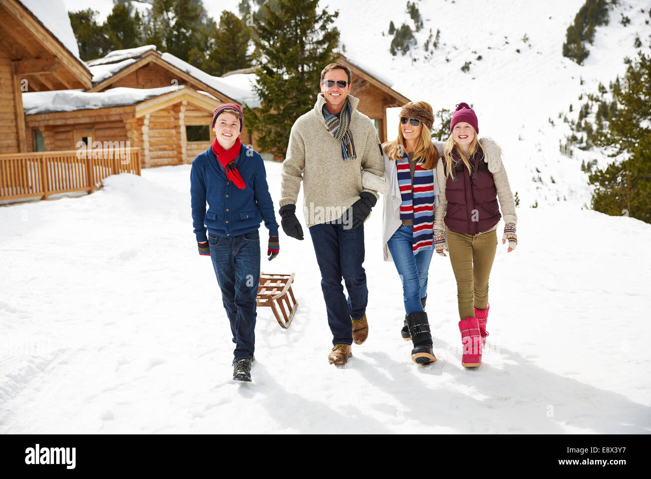 Family walking through snow together - Stock Image
