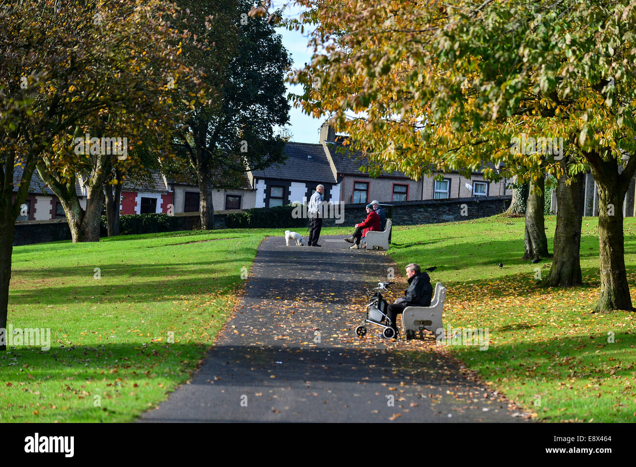 Stock Photo - Older men sitting in the sunshine in park, Derry, Londonderry, Northern Ireland. ©George Sweeney - Stock Image