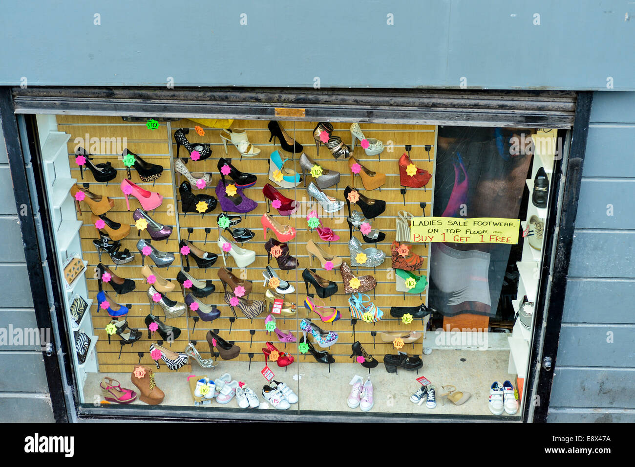 Stock Photo - Display of women's shoes in shop window, Derry, Londonderry, Northern Ireland. ©George Sweeney - Stock Image