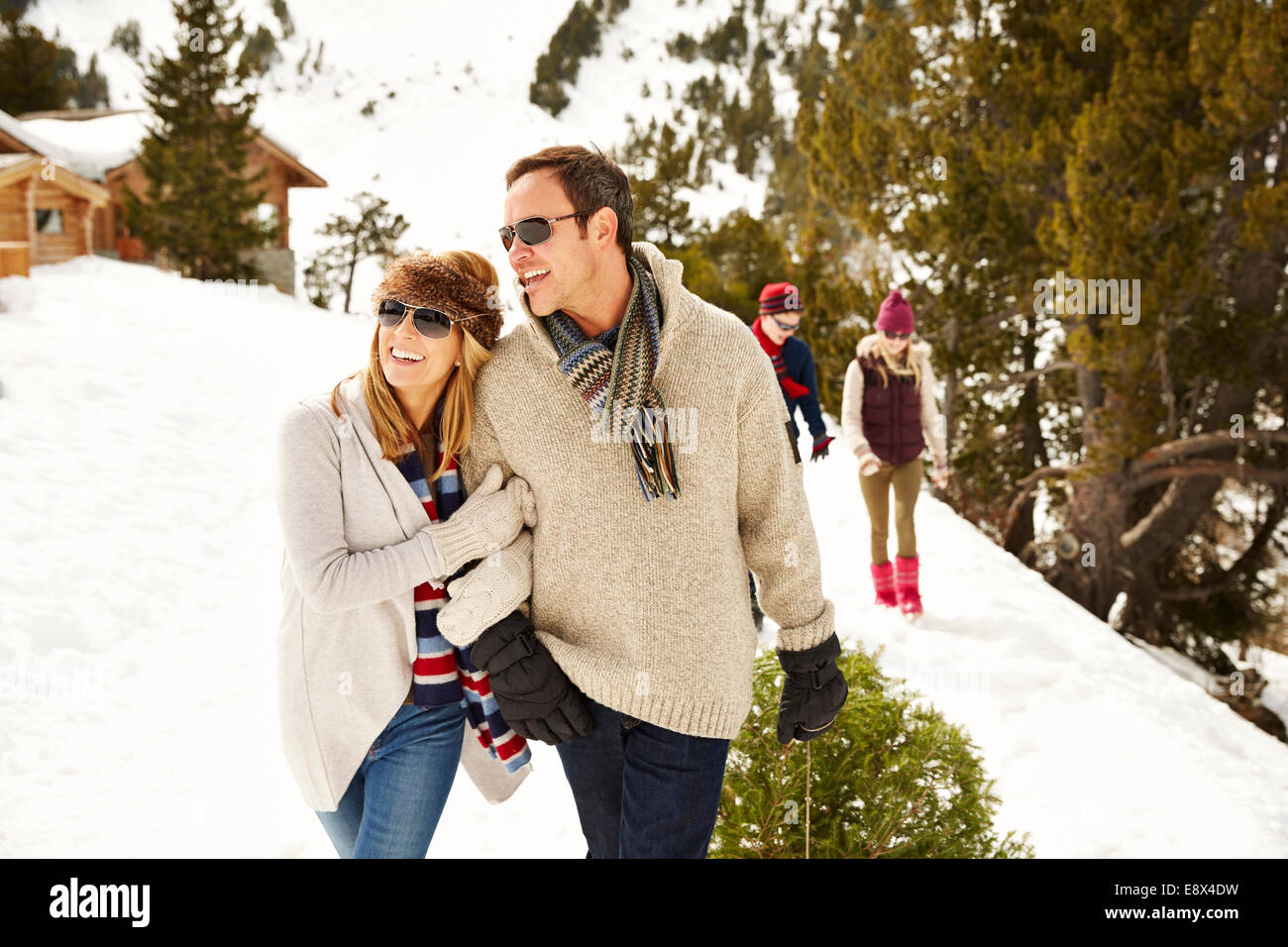 Couple walking through snow together - Stock Image