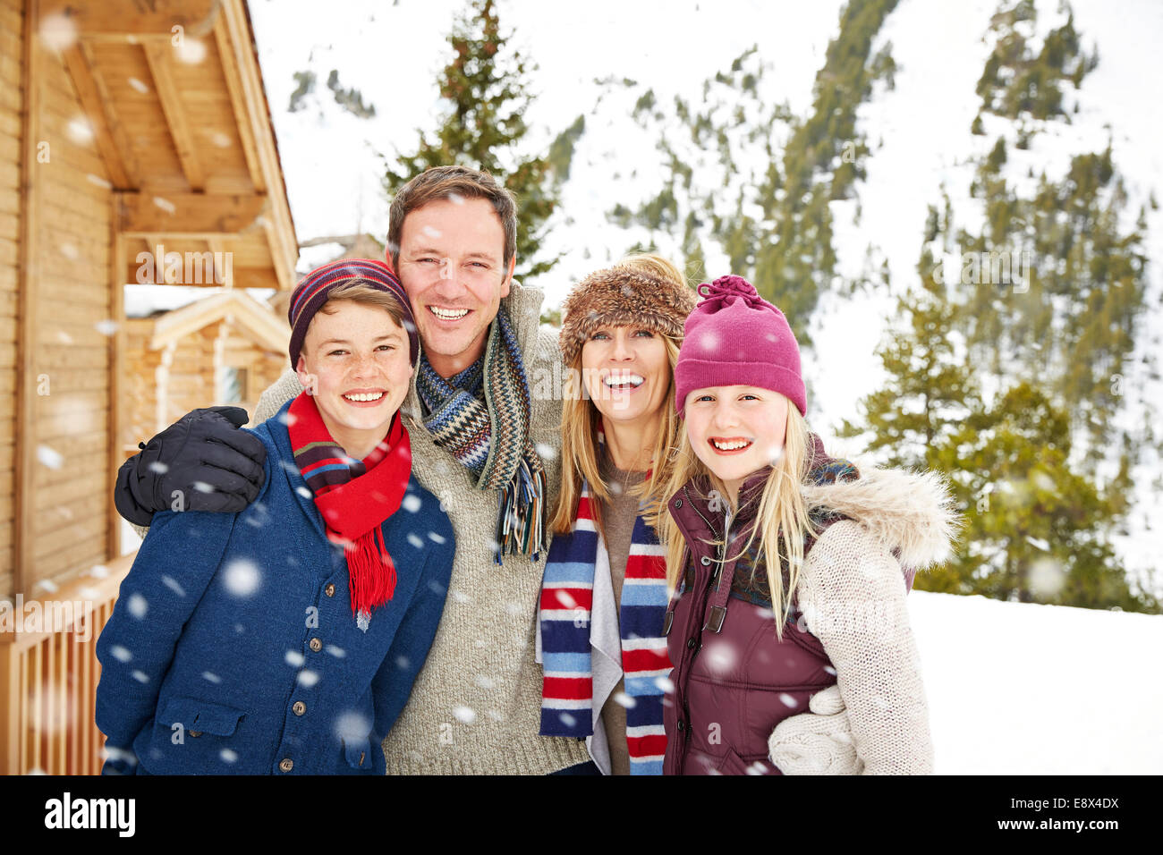 Family hugging in the snow - Stock Image